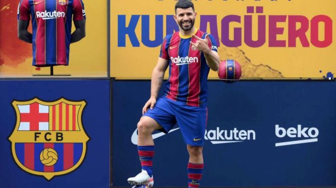 Former Manchester City's player, Argentine forward Sergio Agüero poses on the pitch of the Camp Nou stadium in Barcelona during his official presentation as new player of FC Barcelona on May 31, 2021.