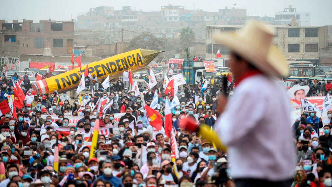People gather to listen to Pedro Castillo speak at a campaign rally in Lima on May 27.