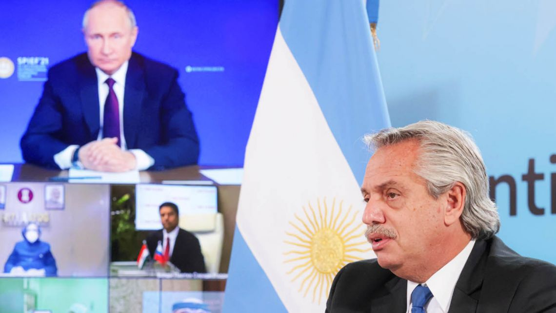 President Alberto Fernández speaks during a videoconference call with Russian leader Vladimir Putin announcing the beginning of mass production of the coronavirus vaccine in Argentina.