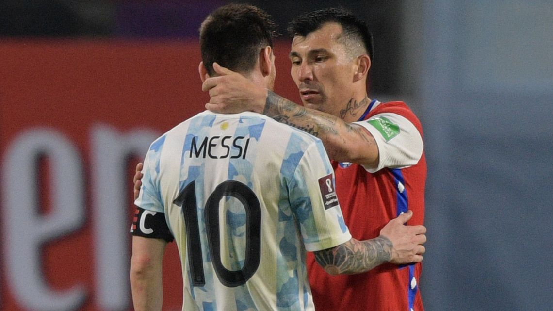 Argentina's Lionel Messi and Chile's Gary Medel greet each other after drawing 1-1 in their South American qualification football match for the FIFA World Cup Qatar 2022 at the Estadio Unico Madre de Ciudades stadium in Santiago del Estero, Argentina, on June 3, 2021.
