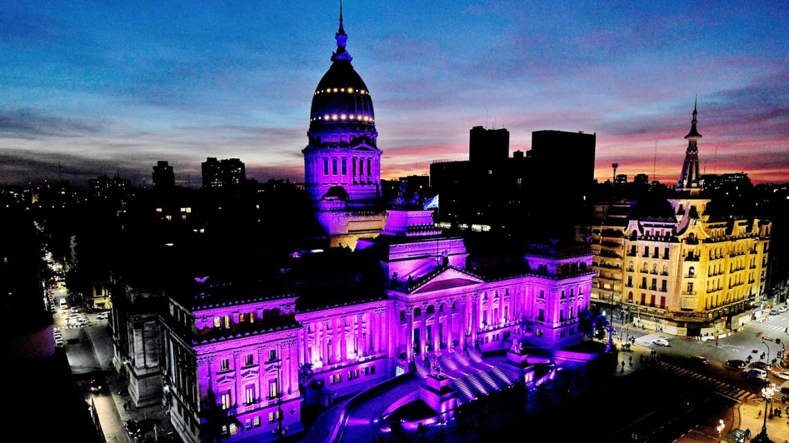 Argentina's Congress is bathed in purple light to mark the sixth anniversary of the inaugural Ni Una Menos march against gender violence.