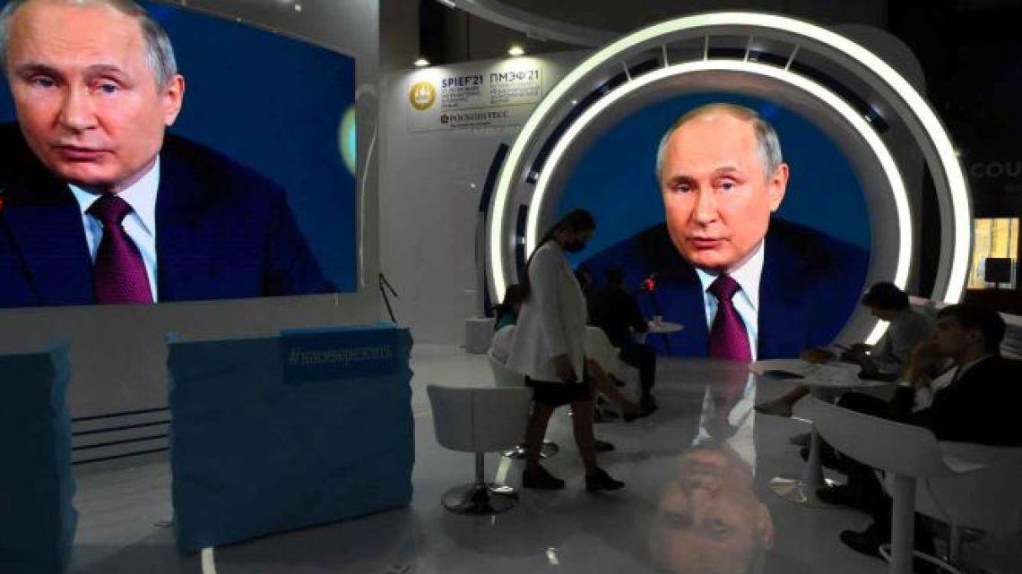 Screens show Russian President Vladimir Putin speaking during a plenary session of the St. Petersburg International Economic Forum (SPIEF) in Saint Petersburg on June 4, 2021.