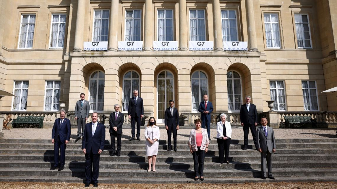 From left: European Commissioner for Economy Paolo Gentiloni, Eurogroup President Paschal Donohoe, President of the World Bank David Malpass, Italy's Economy and Finance Minister Daniele Franco, France's Economy and Finance Minister Bruno Le Maire, Canada's Finance Minister Chrystia Freeland, Britain's Chancellor of the Exchequer Rishi Sunak, Managing Director of the IMF Kristalina Georgieva, Germany's Finance Minister Olaf Scholz, US Treasury Secretary Janet Yellen, Secretary-General of the Organisation for Economic Co-operation and Development (OECD) Mathias Cormann, and Japan's Finance Minister Taro Aso pose for a family photoon the second day of the G7 Finance Ministers Meeting, at Lancaster House in London on June 5, 2021.