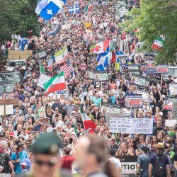 Canadá, Montreal: la gente participa en una manifestación contra las medidas de coronavirus impuestas por el gobierno canadiense. | Foto:Graham Hughes / The Canadian Press vía ZUMA / DPA