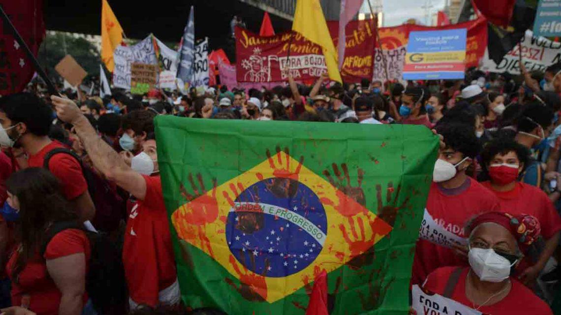 Demonstrators take part in a protest against Brazilian President Jair Bolsonaro's handling of the Covid-19 pandemic in São Paulo, Brazil on May 29 2021.