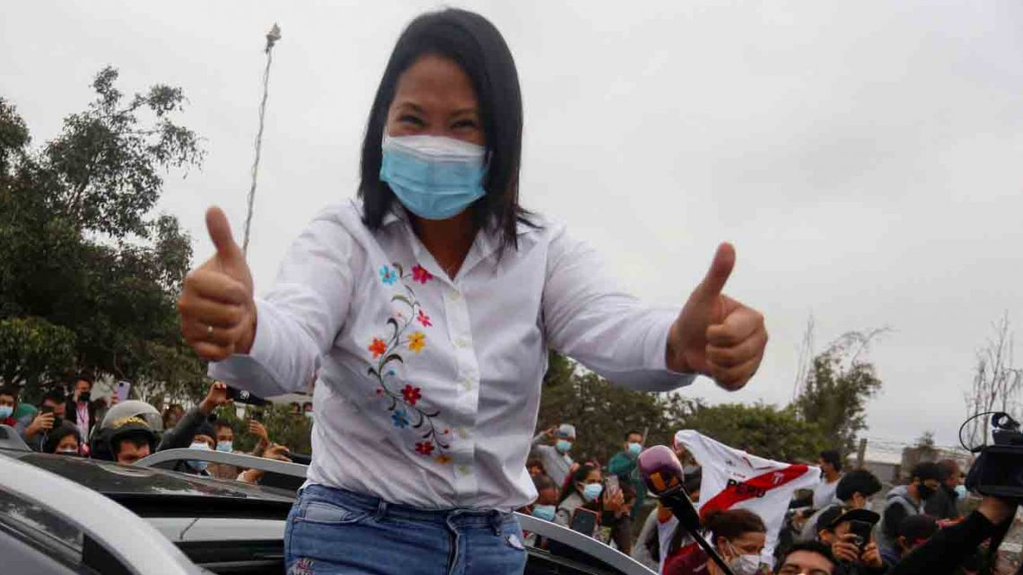 Peruvian presidential candidate, right-wing Keiko Fujimori, greets her supporters as she leaves the polling station after casting her vote, during the presidential runoff election in Lima, on June 6, 2021.