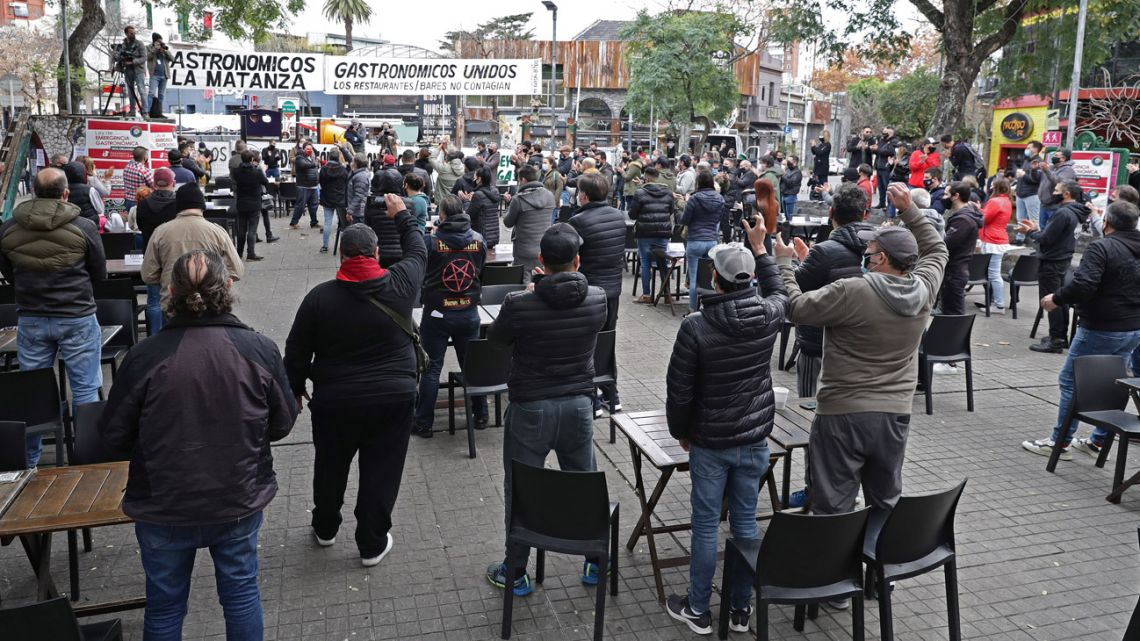 Employees and customers take part in an open-air salon set up by owners of restaurants as a protest against the restrictions imposed by President Alberto Fernández's government due to the coronavirus pandemic at Plaza Serrano, in Palermo, Buenos Aires.