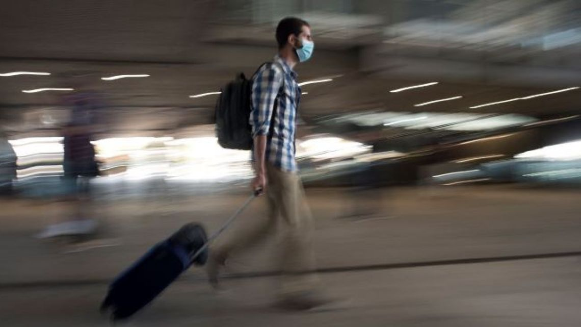A man pulls a suitcase at Malaga-Costa del Sol Airport on June 7, 2021 in Malaga, Spain.