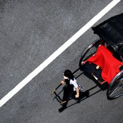 Japón, Tokio: un conductor de un automóvil tradicional japonés llamado  | Foto:Ramiro Agustin Vargas Tabares / ZUMA Wire / DPA