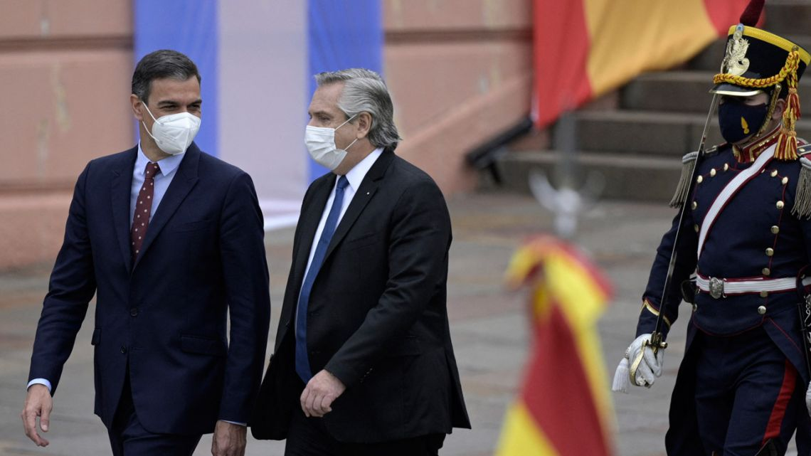 Spain's Prime Minister Pedro Sánchez and President Alberto Fernández arrive to deliver a joint press conference outside the Casa Rosada on June 9, 2021.