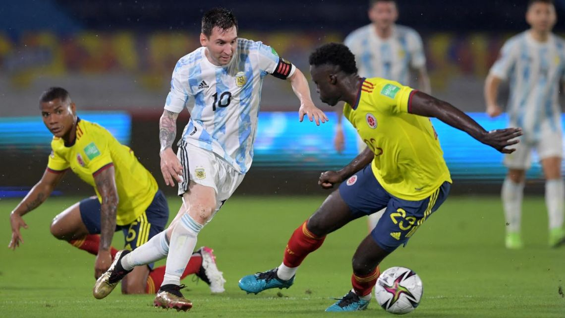 Argentina's Lionel Messi takes on Colombian defender Davinson Sánchez during the two sides' recent World Cup qualifier.