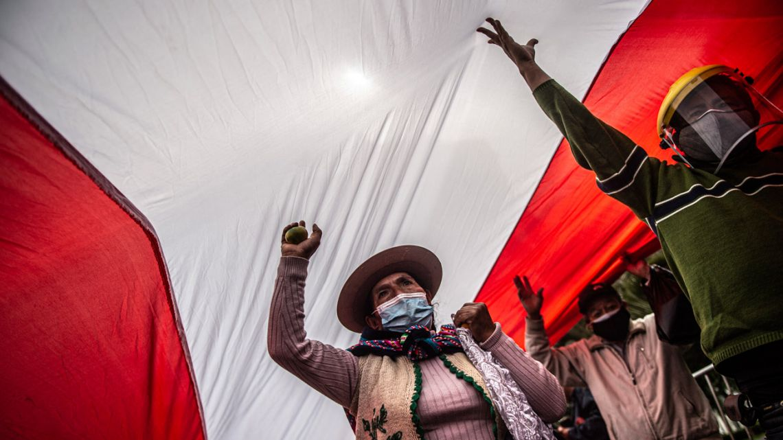 Supporters of the Peruvian left-wing presidential candidate for Peru Libre party, Pedro Castillo, protest in front of the National Jury of Elections building in Lima, on June 09, 2021.