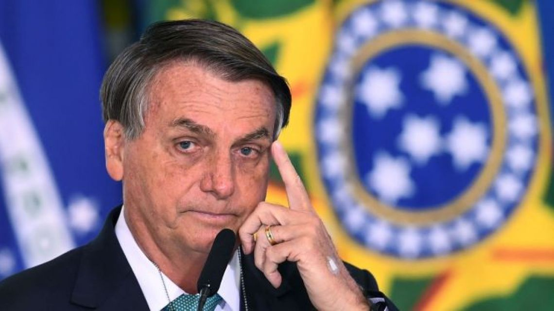 Brazilian President Jair Bolsonaro delivers a speech during the announcement of sponsorship of Olympic sports team by the state bank Caixa Economica Federal at Planalto Palace on June 1, 2021.