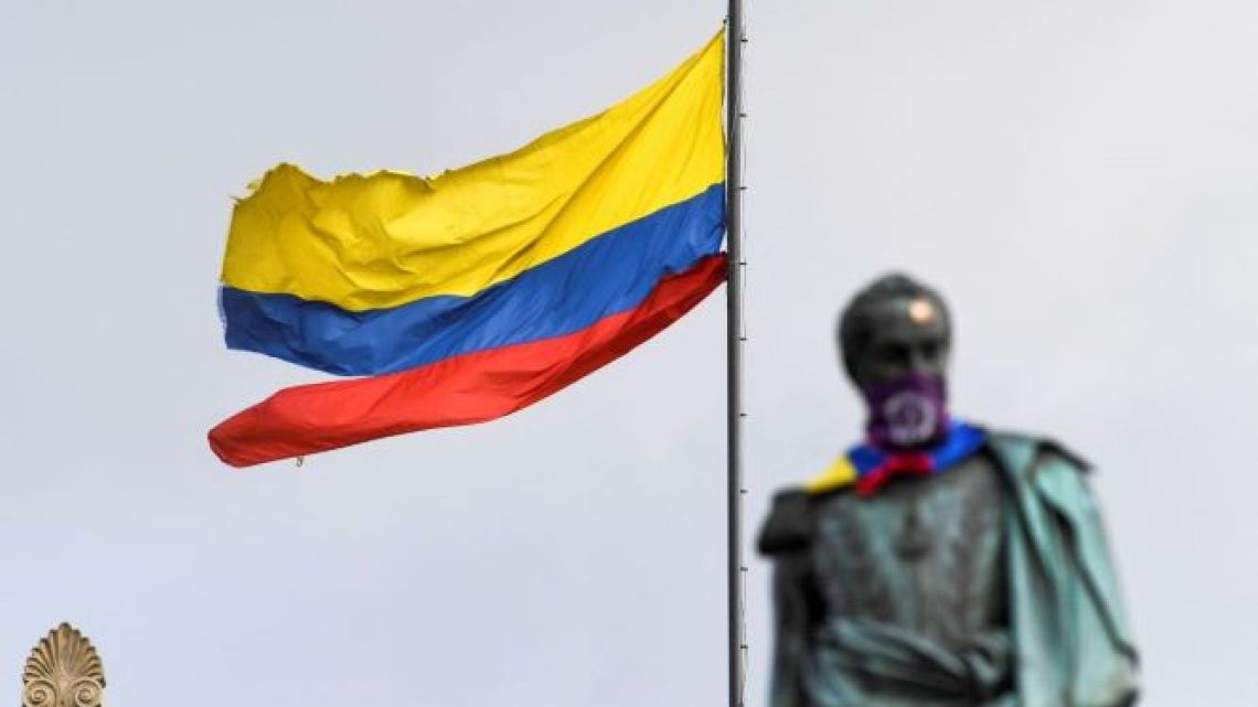 A ripped Colombian flag and a monument to Liberator Simon Bolivar are seen at the Congress building during a protest against the government of Colombian President Ivan Duque in Bogotá, on June 2, 2021.
