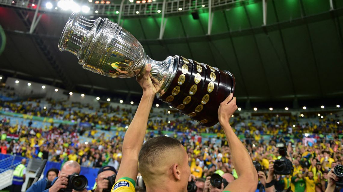 Brazil's Richarlison holds up the Copa América trophy, after the team's win two years ago.