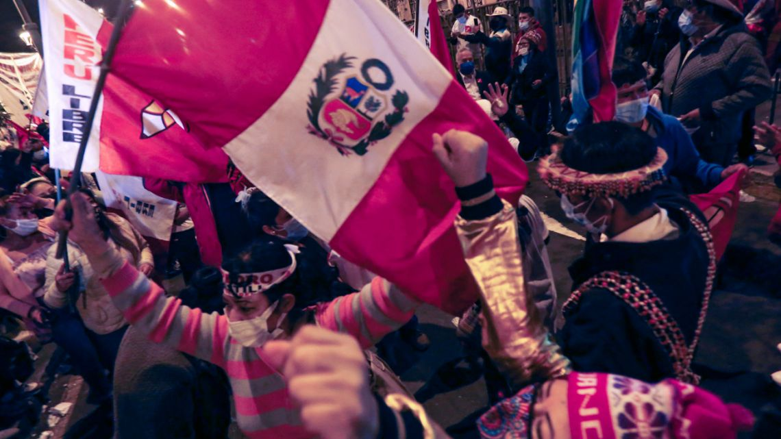 Supporters of Peruvian leftist presidential candidate Pedro Castillo celebrate outside his party's headquarters in Lima on June 15, 2021.