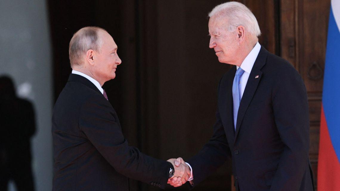 Russian President Vladimir Putin shakes hands with US President Joe Biden prior to their meeting at the 'Villa la Grange' in Geneva on June 16, 2021.