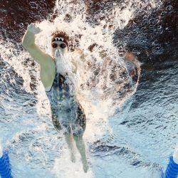 Katie Ledecky, de Estados Unidos, compite en una eliminatoria preliminar de los 400 metros libres femeninos durante el segundo día de las pruebas de natación del equipo olímpico de Estados Unidos 2021 en el CHI Health Center en Omaha, Nebraska.   Foto:Tom Pennington / Getty Images / AFP