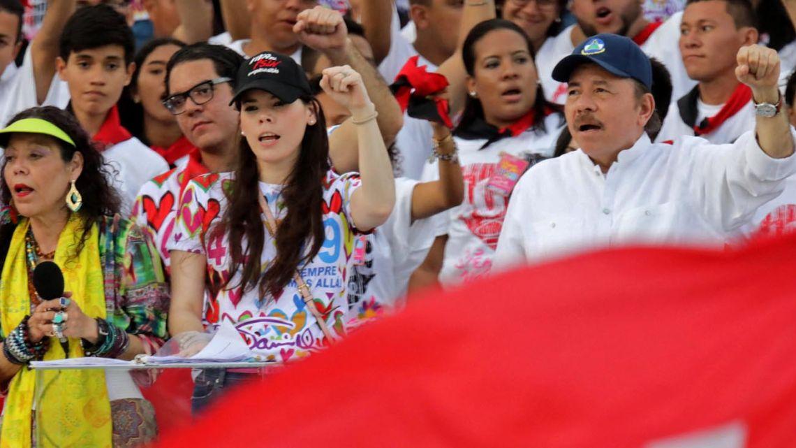 "Nicaraguan President Daniel Ortega (right), his wife, Vice-President Rosario Murillo (left) and their daughter Camila Ortega (centre), attend an event commemorating the 40th anniversary of the Sandinista Revolution at ""La Fe"" square in Managua."