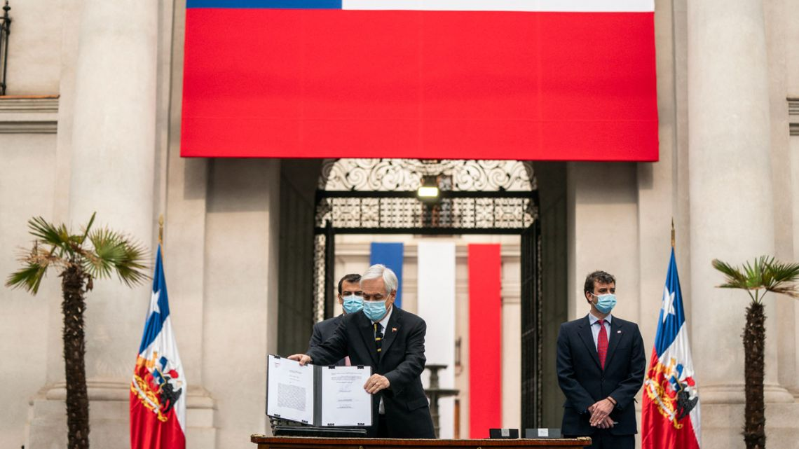 Handout picture released by the Chilean Presidency shows President Sebastián Piñera announcing the inauguration of the Constitutional Assembly of Chile for next July 4, in Santiago, on June 20, 2021.