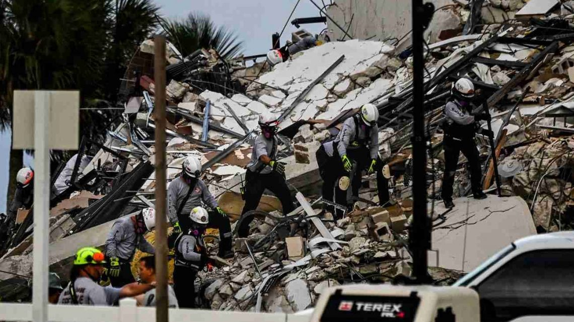Search and Rescue personnel work at a partial collapse building in Surfside, Miami Beach, on June 24, 2021.