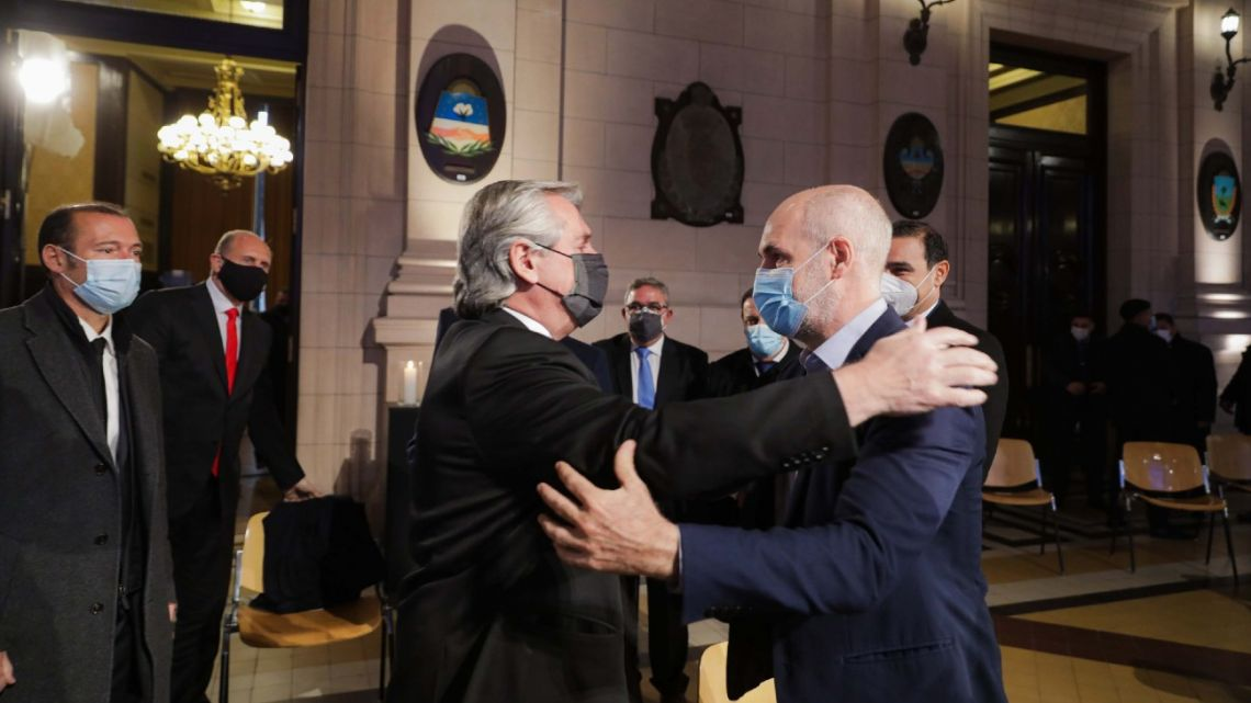 President Alberto Fernández greets Buenos Aires City Mayor Horacio Rodríguez Larreta, prior to an event at the CCK cultural centre in Buenos Aires marking 100,000 deaths from the novel coronavirus.