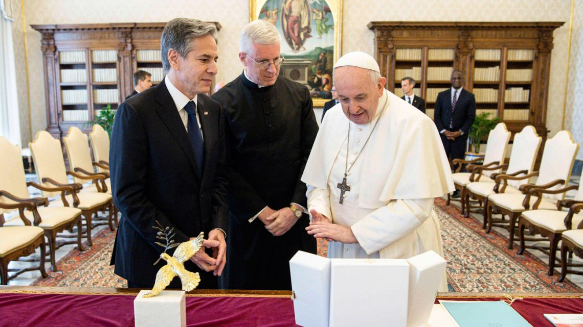 This handout picture taken and released by the Vatican Media on June 28, 2021 shows Pope Francis (right) meeting with US Secretary of State Antony Blinken (left) at the Vatican, as part of a three-nation tour of Europe.