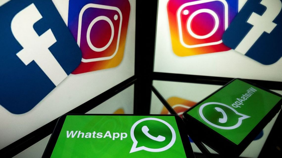 In this file photo taken on October 05, 2020 this picture shows logos of US social networks Facebook, Instagram and mobile messaging service WhatsApp on the screens of a smartphone and a tablet in Toulouse, southwestern France.