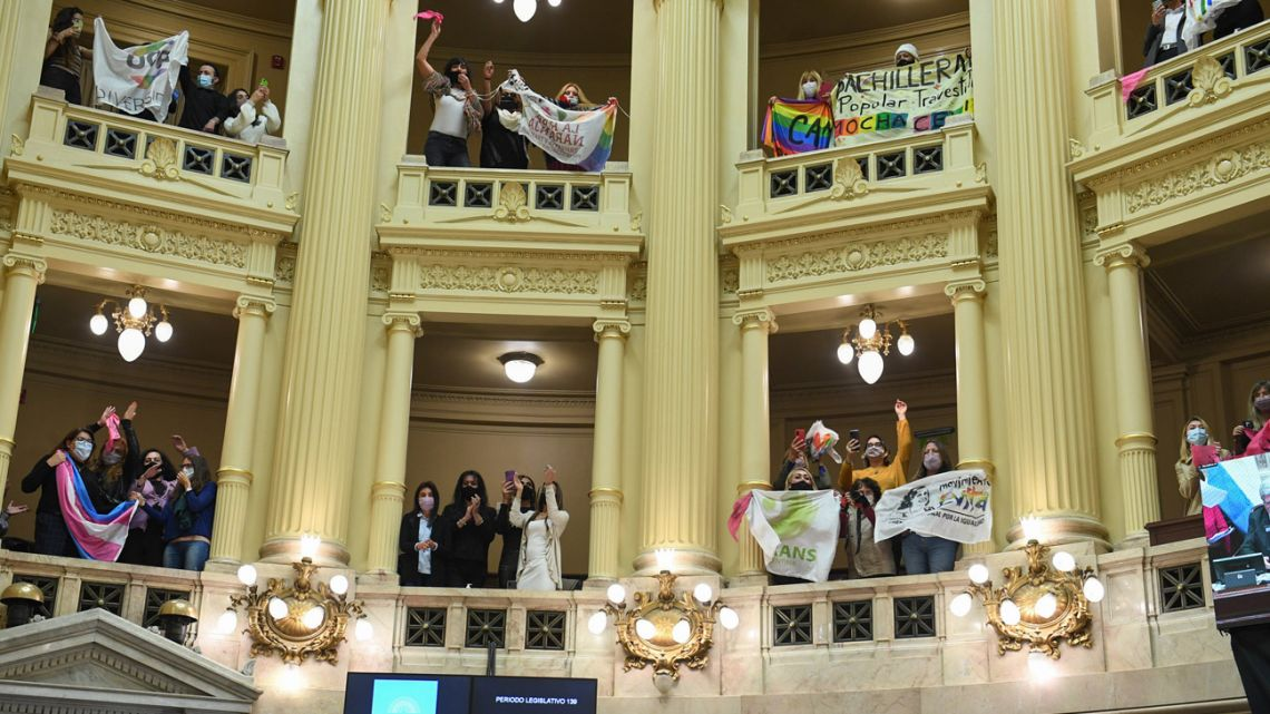 Activists hail the passage of the trans job quota law in Argentina's Senate.