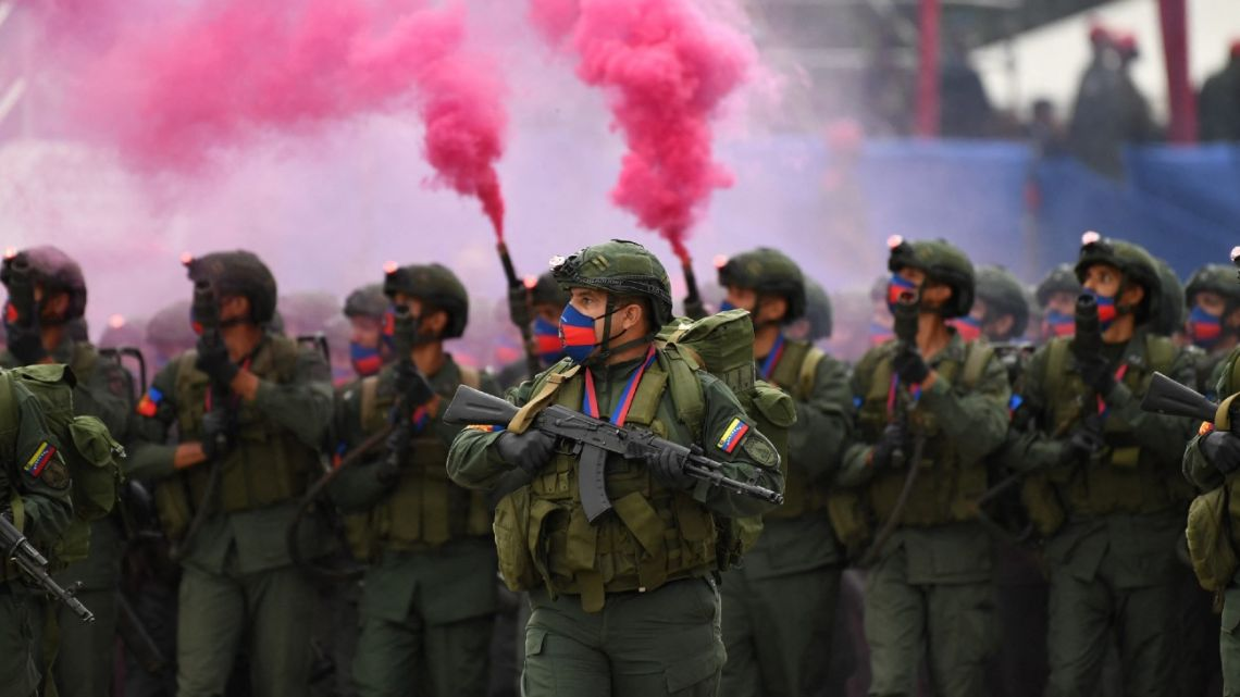 Venezuelan troops march during a military parade in the framework of the Carabobo Battle Bicentennial celebrations at the Carabobo military camp in Valencia, Carabobo state, on June 24, 2021.