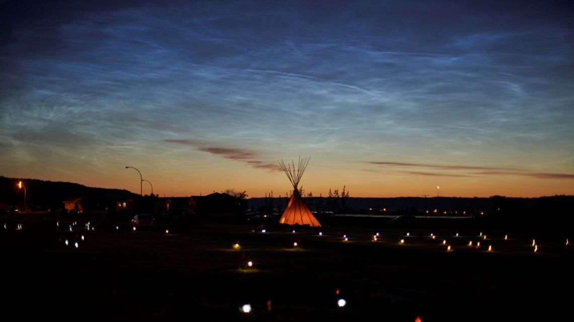 In this file photo solar lights and flags now mark the spots where 751 human remains were recently discovered in unmarked graves at the site of the former Marieval Indian Residential School on the Cowessess First Nation in Saskatchewan on June 27, 2021.