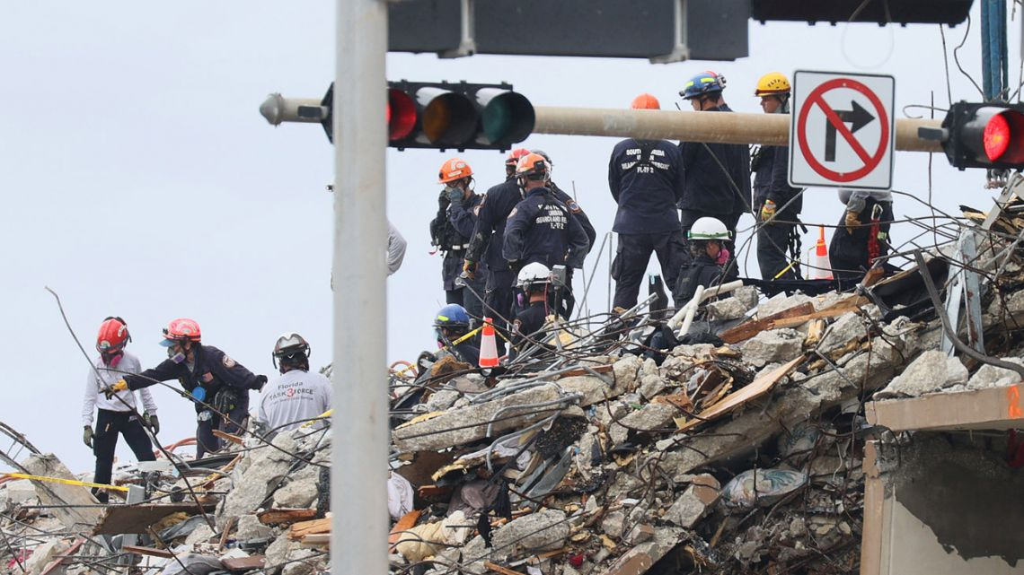 earch and Rescue teams look for possible survivors and to recover remains in the partially collapsed 12-story Champlain Towers South condo building on June 30, 2021 in Surfside, Florida.
