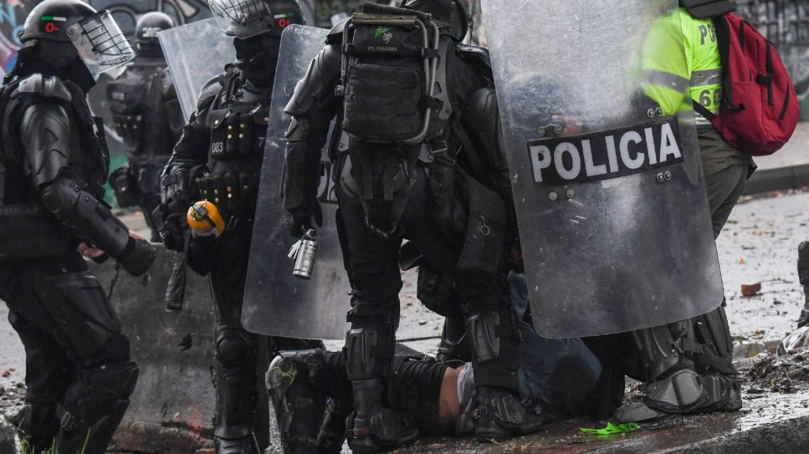 Riot police detain a demonstrator during a protest against the government of Colombian President Iván Duque, in Bogotá on June 9, 2021.