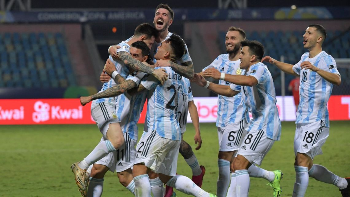 Argentina's Lionel Messi is mobbed by his teammates after scoring the Albiceleste's third goal against Ecuador during their CONMEBOL 2021 Copa América quarter-final match at the Olympic Stadium in Goiânia, Brazil, on July 3, 2021.