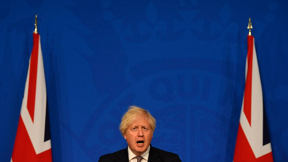 Britain's Prime Minister Boris Johnson gives an update on relaxing restrictions imposed on the country during the coronavirus covid-19 pandemic at a virtual press conference inside the Downing Street Briefing Room in central London on July 5, 2021.