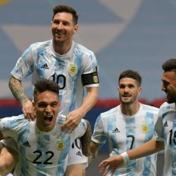 Argentina's Lautaro Martínez celebrates with teammates Lionel Messi, Nicolás González and Rodrigo De Paul after scoring against Colombia during their CONMEBOL 2021 Copa América semi-final clash at the Mané Garrincha Stadium in Brasilia, Brazil, on July 6, 2021.