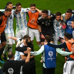 Argentina's goalkeeper Emiliano Martínez celebrates with teammates at the end of the Conmebol 2021 Copa America football tournament semi-final match against Colombia at the Mané Garrincha Stadium in Brasilia, Brazil, on July 6, 2021.