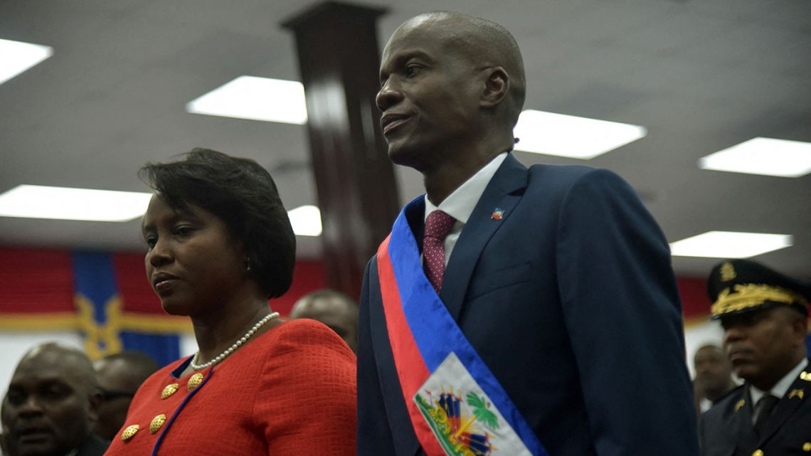 In this file photo Haitian President Jovenel Moise stands with his wife after receiving his sash during his Inauguration, at the Haitian Parliament in Port-au-Prince, on February 7, 2017. Haiti President Jovenel Moise was assassinated and his wife wounded early July 7, 2021 in an attack at their home, the interim prime minister announced, an act that risks further destabilizing the Caribbean nation beset by gang violence and political volatility.