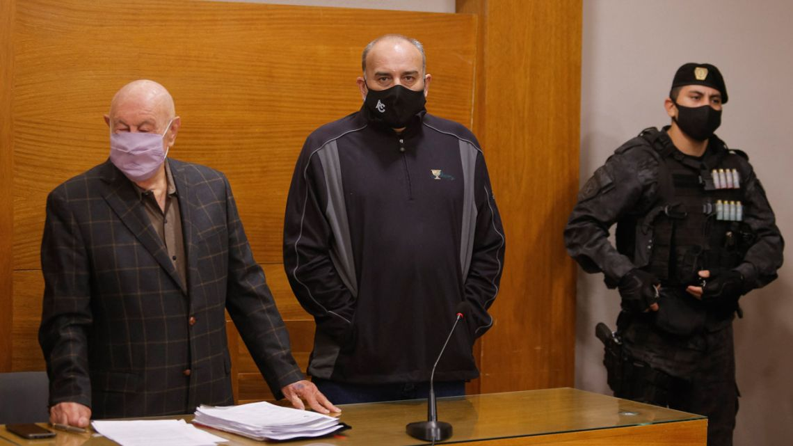 Argentine golfer Ángel Cabrera (centre) stands next to his lawyer Carlos Hairabedian, before a hearing as part of his trial for gender violence and theft in Córdoba, Argentina, on July 7, 2021.