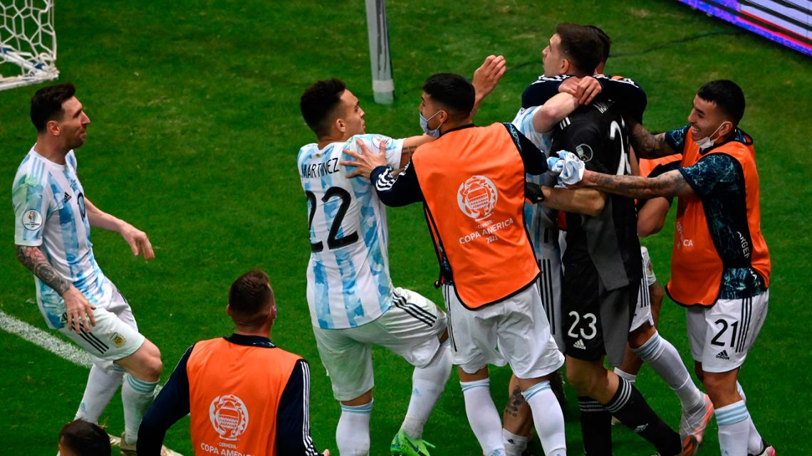 Argentina's players celebrate at the end of the CONMEBOL 2021 Copa América semi-final match against Colombia at the Mané Garrincha Stadium in Brasilia, Brazil, on July 6, 2021.