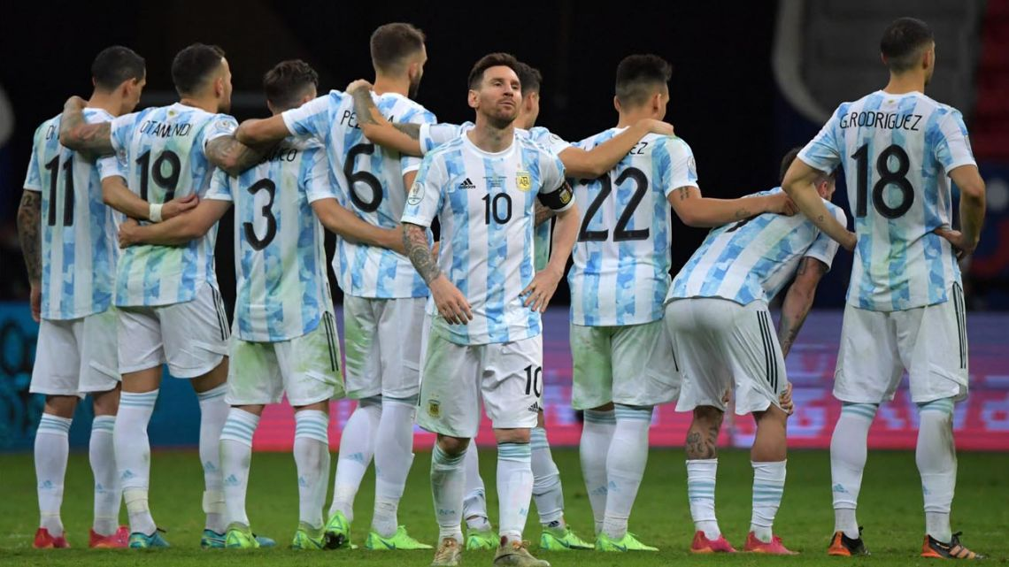Argentina's Lionel Messi, backdropped by the rest of his Albiceleste teammates, during the penalty shoot-out victory over Colombia.