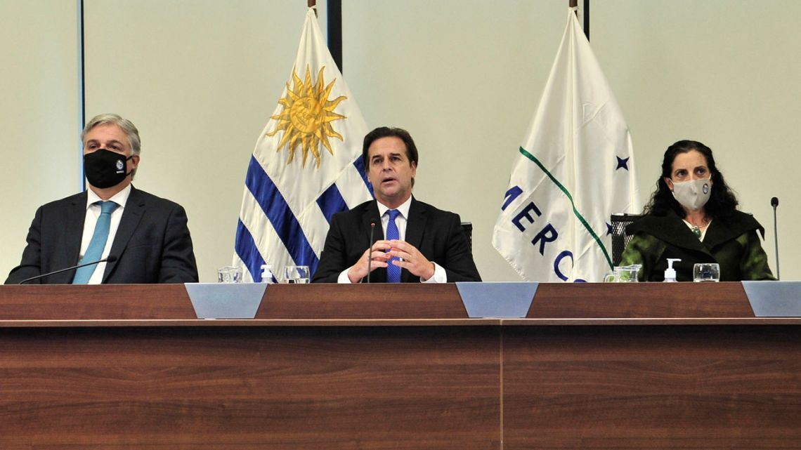 Handout photo released by Uruguay's Presidency of Luis Lacalle Pou (centre), Economy Minister Azucena Arbeleche (second-right) and Foreign Minister Francisco Bustillo (second-left) attending a Mercosur Summit from Montevideo, on July 8, 2021.