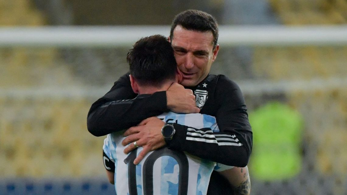 Argentina's Lionel Messi and coach Lionel Scaloni embrace after winning the CONMEBOL 2021 Copa América.