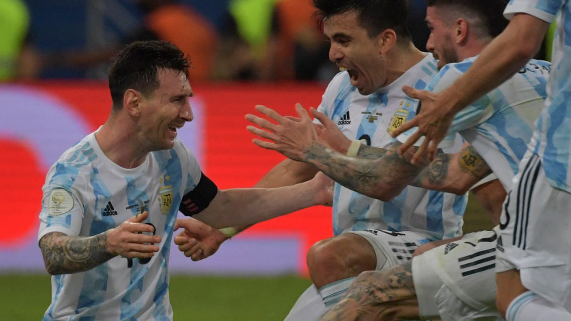 Argentina's Lionel Messi (left) celebrates with teammates after winning the CONMEBOL 2021 Copa América final against Brazil at Maracanã stadium in Rio de Janeiro, Brazil, on July 10, 2021.