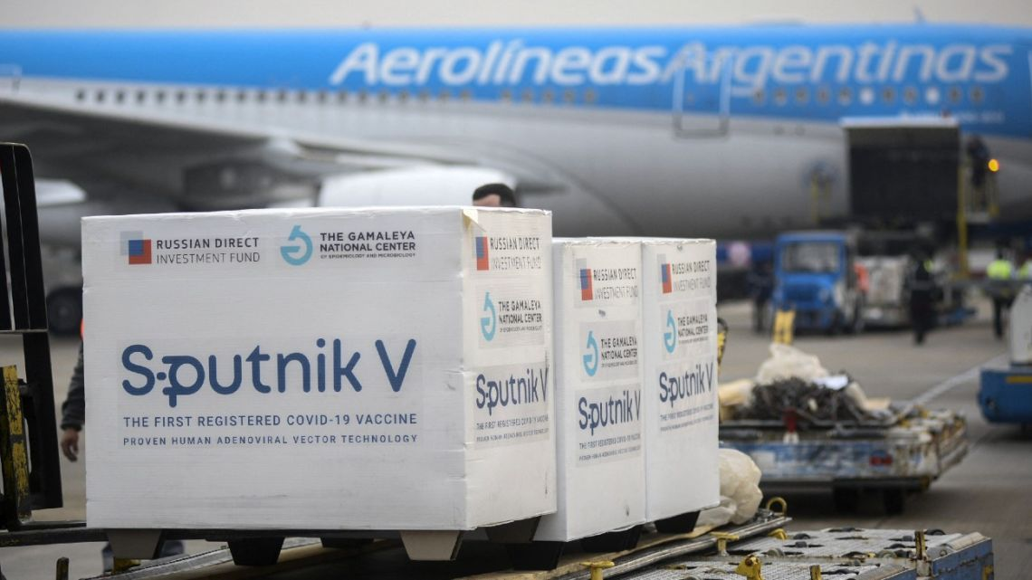 Handout photo released by the Presidency shows containers that form part of a shipment of 550,000 Sputnik V second component doses of Covid-19 vaccine, upon their arrival from Moscow, Russia, at Ezeiza International Airport in Buenos Aires Province, Argentina, on July 12, 2021.