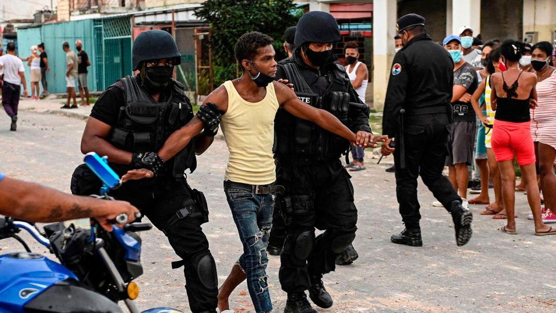 A demonstrator is arrested in Cuba in July 2021.
