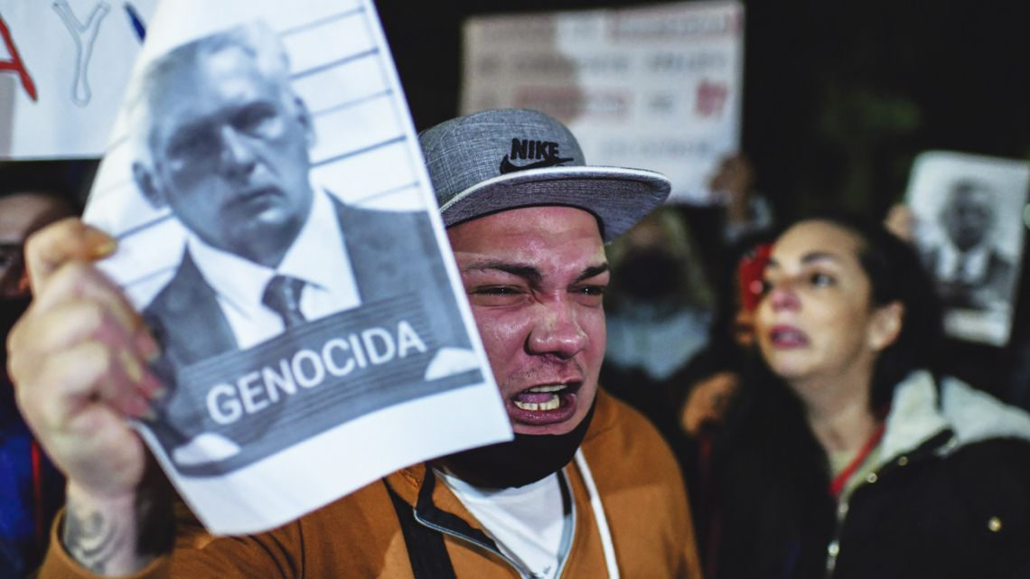 Protesters rally outside the Cuban Embassy in Belgrano, Buenos Aires, earlier this week.