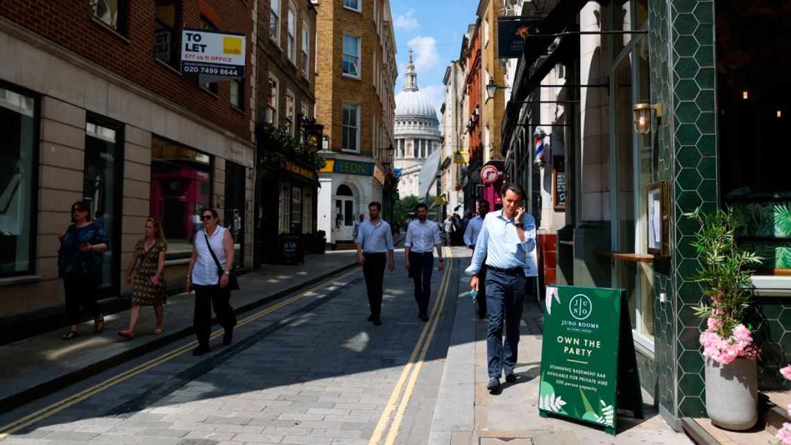 Pedestrians walk along Watling Street, on so-called 'Freedom Day', in the City of London, England, on Monday, July 19, 2021.