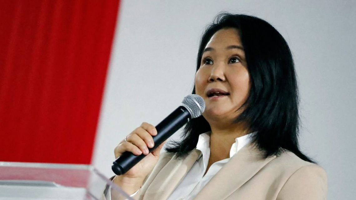 Picture made available by the Peruvian national press agency Andina showing right-wing presidential candidate Keiko Fujimori speaking to the press at the Fuerza Popular party's headquarters in Lima on July 19, 2021.