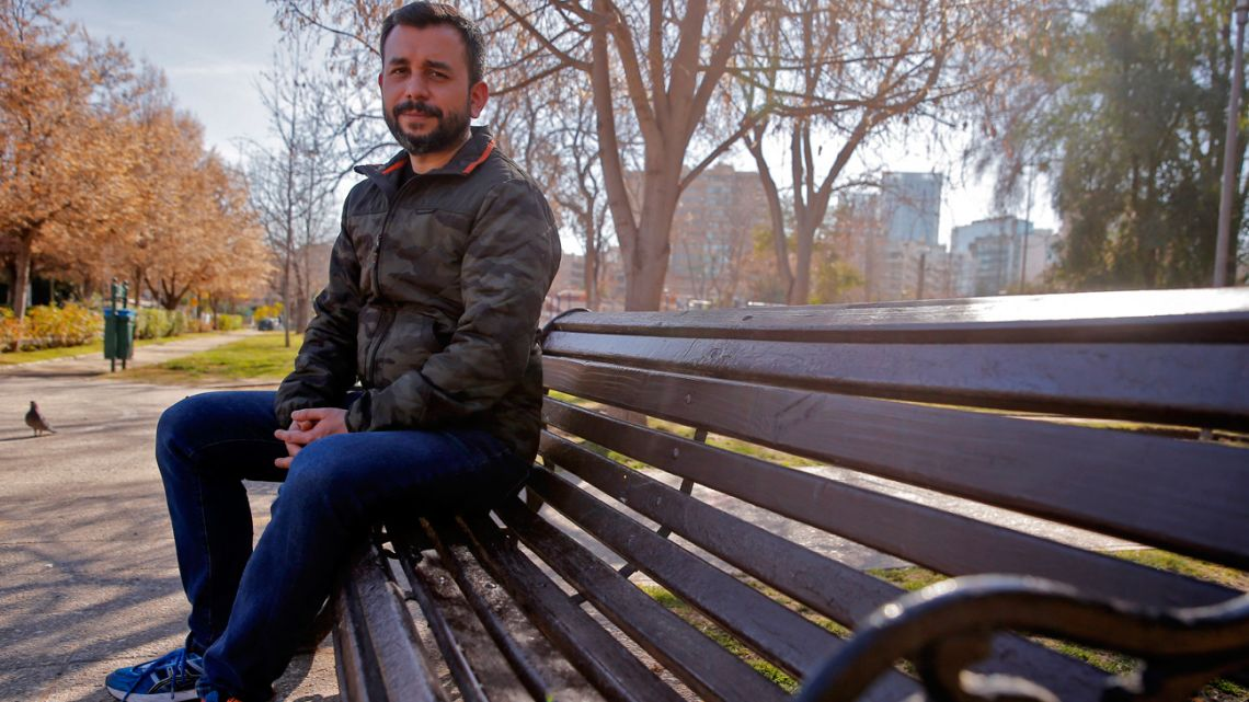 The spokesman of the Homosexual Integration and Liberation Movement (Movilh) Oscar Rementeria, 41, poses in Santiago on July 20, 2021. The Chilean Senate votes Wednesday a bill on equal marriage. JAVIER TORRES / AFP